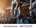 sport fitness man hitting wheel ...
