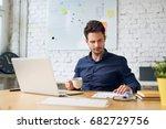 focused handsome office worker...   Shutterstock . vector #682729756
