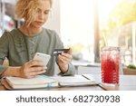 gorgeous businesswoman sititng... | Shutterstock . vector #682730938