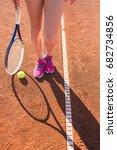 female legs with tennis racket   Shutterstock . vector #682734856