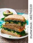 Small photo of avocado ,turkey, arugula sandwich with aioli..selective focus