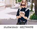 young beautiful girl using... | Shutterstock . vector #682744498