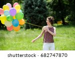 girl with colorful balloons... | Shutterstock . vector #682747870