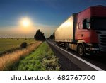truck transportation at sunset | Shutterstock . vector #682767700