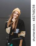 beautiful teen girl chewing gum.... | Shutterstock . vector #682768258