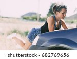girl near the car with the... | Shutterstock . vector #682769656