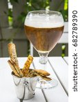 a glass of beer with a snack on ... | Shutterstock . vector #682789390