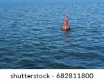 lonely lighthouse buoy in a... | Shutterstock . vector #682811800