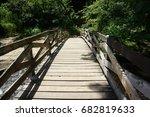 wooden bridge over creek in... | Shutterstock . vector #682819633