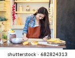 young asian woman cooking whole ... | Shutterstock . vector #682824313