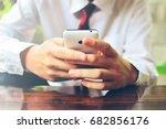 a businessman using a... | Shutterstock . vector #682856176