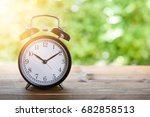 alarm clock on wooden table... | Shutterstock . vector #682858513