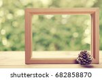 picture frame with pinecone on... | Shutterstock . vector #682858870