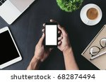 close up on hand holding phone... | Shutterstock . vector #682874494