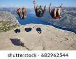 jumpers on preikestolen rock.... | Shutterstock . vector #682962544