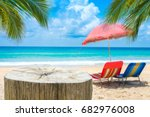 wooden desk or stump on sand... | Shutterstock . vector #682976008