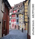 Small photo of Alley with half-timbered houses in Colmar. Alsace, France.