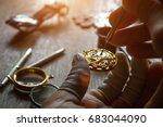 the watchmaker is repairing the ... | Shutterstock . vector #683044090