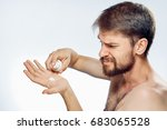 man squeezes the cream on the... | Shutterstock . vector #683065528