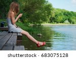 side view of a girl sitting on... | Shutterstock . vector #683075128