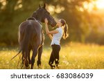 Stock photo young woman with her horse in evening sunset light outdoor photography with fashion model girl 683086039
