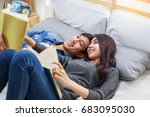 young asian couple lying on the ... | Shutterstock . vector #683095030