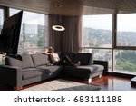 blonde woman sitting on a sofa... | Shutterstock . vector #683111188