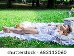 beautiful little girl in a park ... | Shutterstock . vector #683113060
