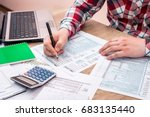 businessman  filling 1040 tax... | Shutterstock . vector #683135440