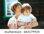 happy grandmother with her... | Shutterstock . vector #683179924