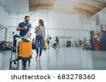 happy smiling couple in airport | Shutterstock . vector #683278360