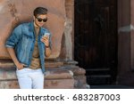 Jolly Young Bearded Man Using...