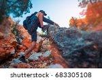 hiker climbs rocky steep terrain   Shutterstock . vector #683305108