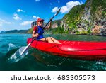 woman paddles red kayak in a... | Shutterstock . vector #683305573