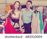 joyful man and woman choose new ... | Shutterstock . vector #683310004
