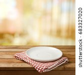 empty white plate on wooden... | Shutterstock . vector #683327020
