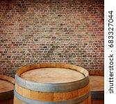 wooden wine barrel over brick... | Shutterstock . vector #683327044