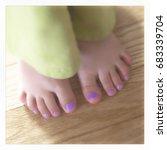 little toddler girl's toes... | Shutterstock . vector #683339704