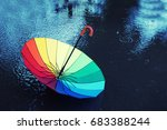 colorful umbrella in the rain.... | Shutterstock . vector #683388244