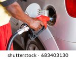 man refueling a car at the