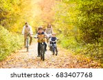 young family in warm clothes... | Shutterstock . vector #683407768