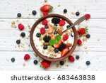 bowl of oat granola with yogurt ... | Shutterstock . vector #683463838