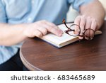 man reading. book in his hands. | Shutterstock . vector #683465689