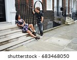 couple on a street | Shutterstock . vector #683468050