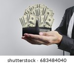 hand holds the purse and money... | Shutterstock . vector #683484040