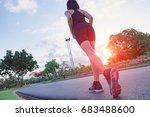 runner feet running on road at... | Shutterstock . vector #683488600
