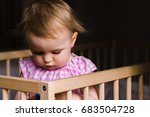 baby girl in a wooden crib... | Shutterstock . vector #683504728
