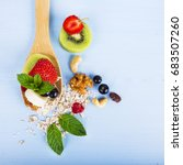 Fruit Salad On A Wooden Spoon