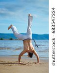man practicing capoeira on the...   Shutterstock . vector #683547334