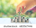 house placed on coins men's... | Shutterstock . vector #683567446